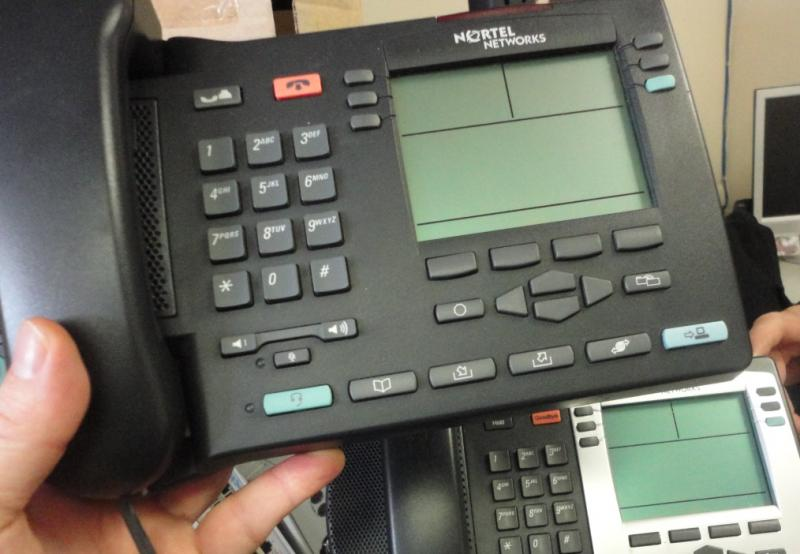how to change name on nortel phone